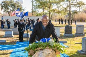 Paul C. Harris, Hampton University Senior Vice President, places commemorative wreath at the gravesite of Gen. Samuel Chapman Armstrong.