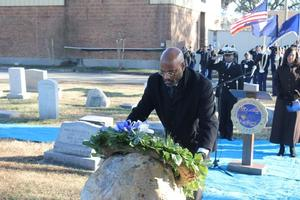 Sr. Vice President Paul Harris lays the wreath at General Armstrong's grave.