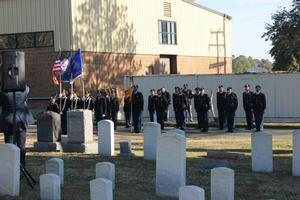 The honor guard and bugler render a tribute with a three round volley and taps.