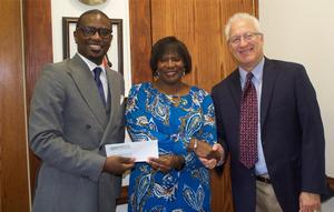 Raphael Brewton (left) and Stuart Goodman, owner of Goodman & Sons Jewelers (far right) present Hampton University's Vice President for Business Affairs and Treasurer, Mrs. Doretha J. Spells, a donation check from the initial sales of the HU Pandora Charms