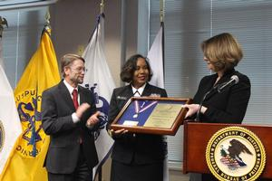 Dr. Schult, Assistant Director Health Services, Federal Bureau of Prisons along with Dr. Allen, Medical Director presents an award to RADM Dunwoody for her outstanding service to the Bureau.