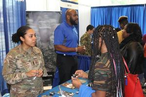 Midshipman Bullock talks about the features of the Navy ROTC program, while Cadet Alleyne and Mr. McDonald talk up the Army ROTC program.