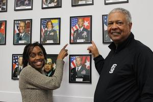 T-Ham and Claude Vann point out her classmate MG Brunson, who was promoted this past Tuesday.