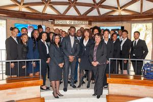 Hampton University School of Business takes a photo with BET representatives, Tiyale Hayes and Morgan Grayned.