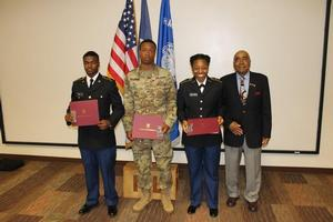 HU Alum LTC(R) John Melvin presented the Military Order of the World Wars Award to Cadet Herah, Cadet Baldwin, and Cadet Peebles-Hampton.