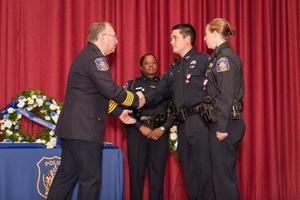 Chief Sult and Officer Deherrara shake hands after award was presented.