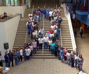 Faculty, staff and students gathered to form the ribbon for Denim Day