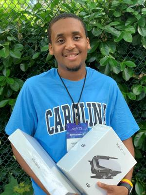 Carlos Mayers with the prizes he won at The Pitch 2019 competition