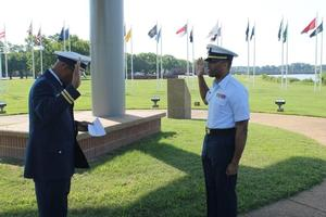 Ensign Banks recites the Oath of Office which was administered by his uncle a retired Coast Guard Lieutenant who worked his way up as enlisted, warrant officer, and finally to the commissioned ranks.