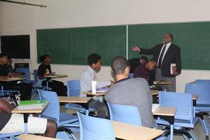 Dr. Calvin Lowe speaks to physics students who are a part of the SSP cohort