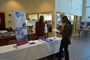 Dwayne Matthews talking to an HU student about the Peace Corps