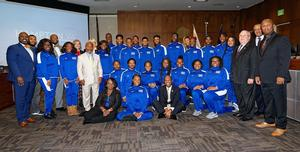 Representatives from The Marching Force and City Council members pose for a photo after the Proclamation is presented
