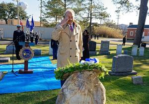 President Harvey salutes General Armstrong's tombstone