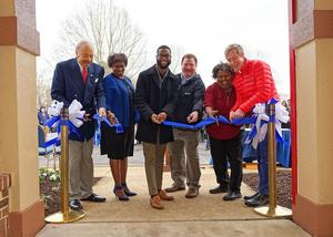 Hampton University and Wendy's representatives cut the ribbon in front of the restaurant for the official grand opening.