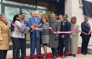 Dr. and Mrs. William R. Harvey cut the ribbon for the Dr. William R. Harvey Musem of Art with Talladega College President Dr. Billy C. Hawkins, his wife and members of Talladega's Board of Trustees.