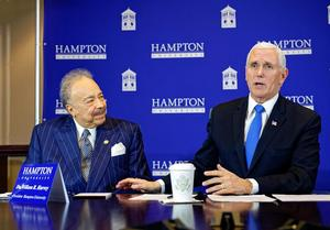 Dr. William R. Harvey and Vice President Michael R. Pence at round table discussion at the Hampton University Proton Therapy Institute
