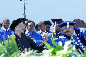 Hampton University President Dr. William R. Harvey embraces keynote speaker Katherine G. Johnson at commencement 2017
