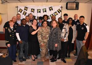 MAJ Hall closes the door on her active duty time with a celebration with her colleagues.