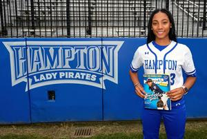 Mo'ne Davis poses with 2014 issue of Sports Illustrated for Kids