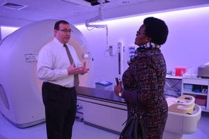 Dr. Vahagn Nazaryan giving Dr. Nomonde Nolutshungo a tour of the PET/CT room at HUPTI