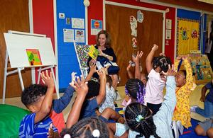 First Lady Pamela Northam reading to the children at the HUCDC