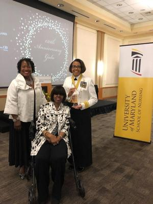 Dr. Pamela Hammond,RADM Trent-Adams, and seated is Dr. LTC(R) Bertha Davis.
