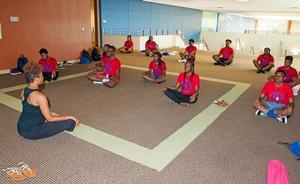 Yoga Instructor, Khalilah Miles teaching a yoga class during the A+ Program