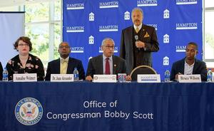 President Dr. William R. Harvey welcomes panel members and guests to Hampton University