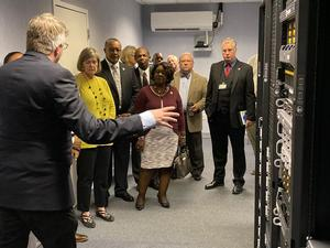 Dr. John McNabb shows attendees the Storm Research Center supercomputer