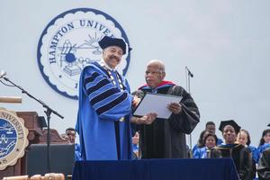 Dr. Harvey conferred the Honorary Doctor of Laws on Congressman Lewis at the 2015 Commencement Ceremony