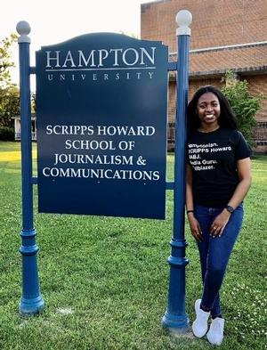 Whitney Bronson in front of the Scripps Howard School of Journalism and Communications