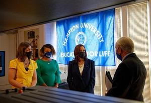 Hampton University Center for Atmospheric Research and Education Professor Dr. M. Pat McCormick presents information on the Lidar Lab to VP Harris and U.S. Rep. Elaine Luria