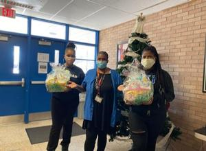 Victoria Joseph and Shelleigh Turner delivering books and treats to downtown Hampton Child Development Center