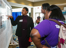 Dr. Shari Wiley engages onlookers during the 2013 School of Science Research Symposium.